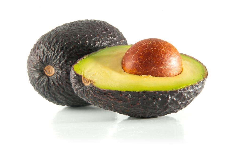 The pit of an avocado can be easily removed by using a sharp knife to cut around the fruit's circumference.