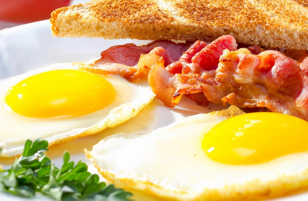 Chicken bacon may be served with eggs.