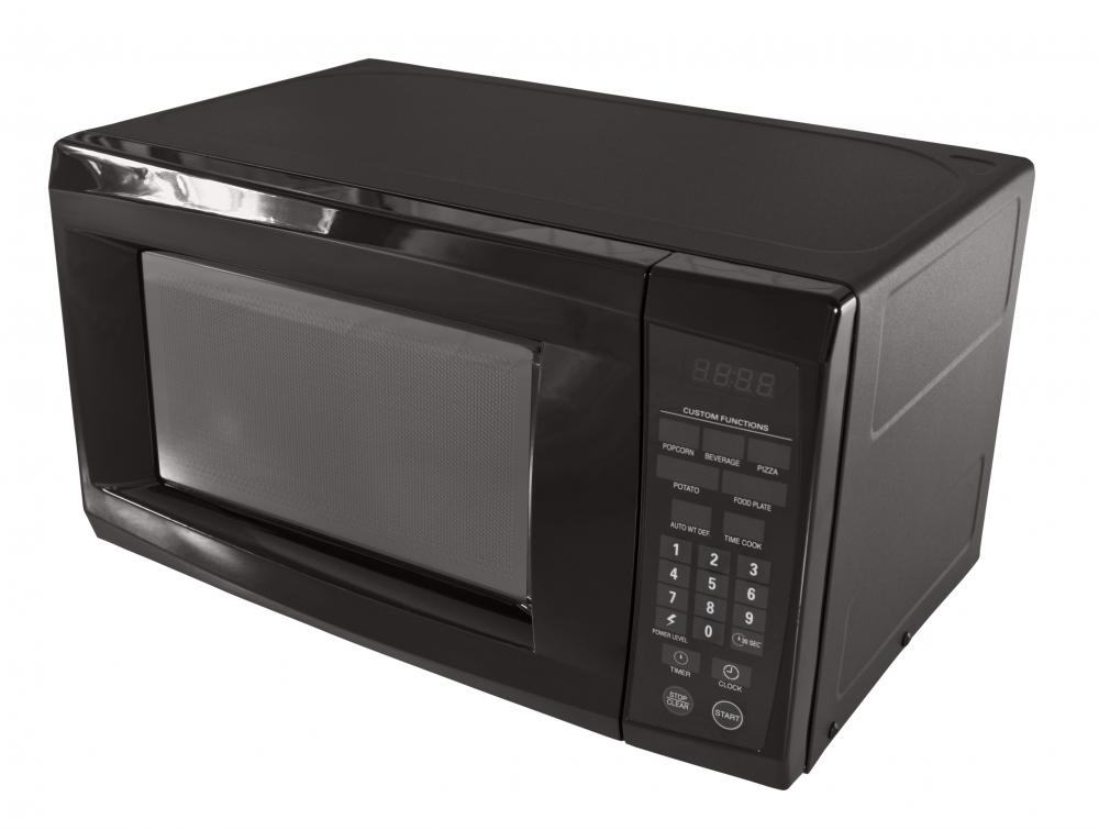 Microwave oven radiation is less energetic than that or ordinary visible light.