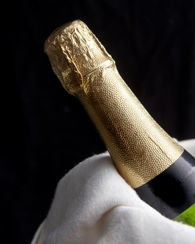 Bottles of champagne are marked up significantly at a restaurant.