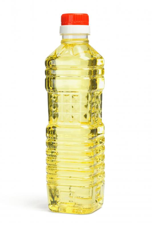 A bottle of corn syrup, which is often used for baking and making candy.