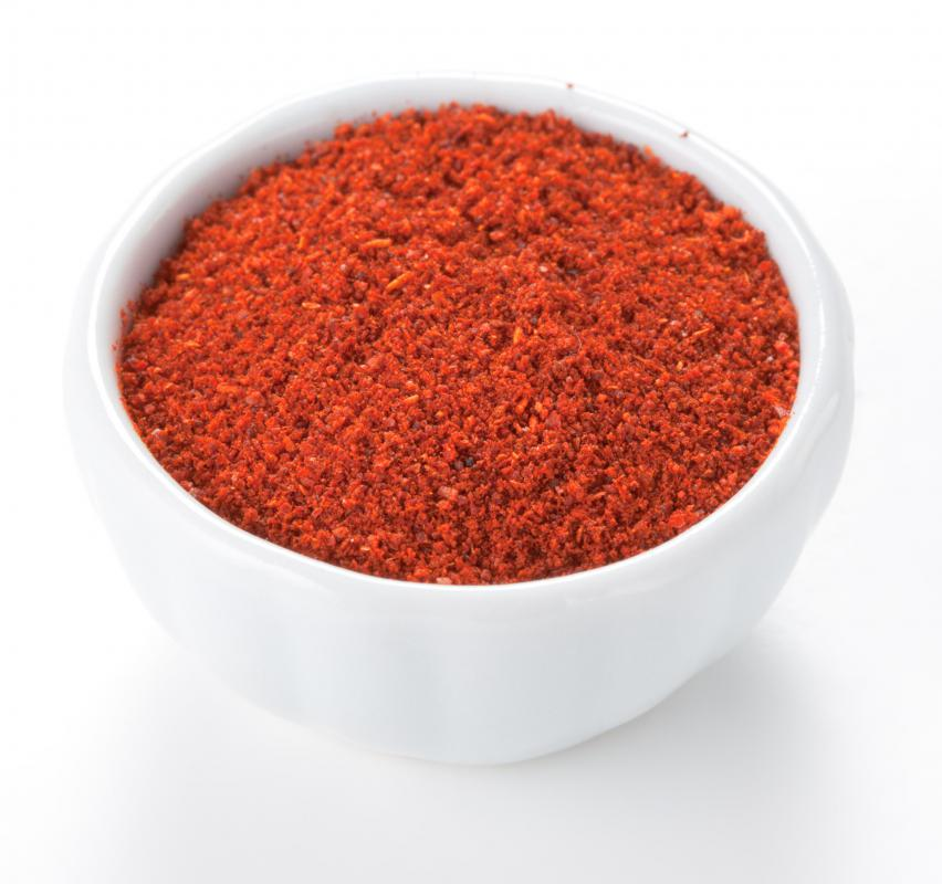 A bowl of paprika, which is typically made with ground pimiento.