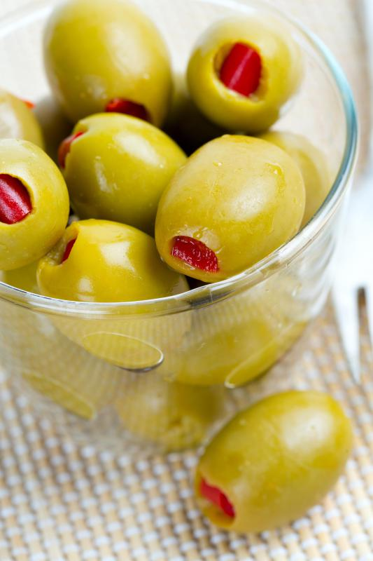 Green olives stuffed with pimiento is a popular use for the pepper.