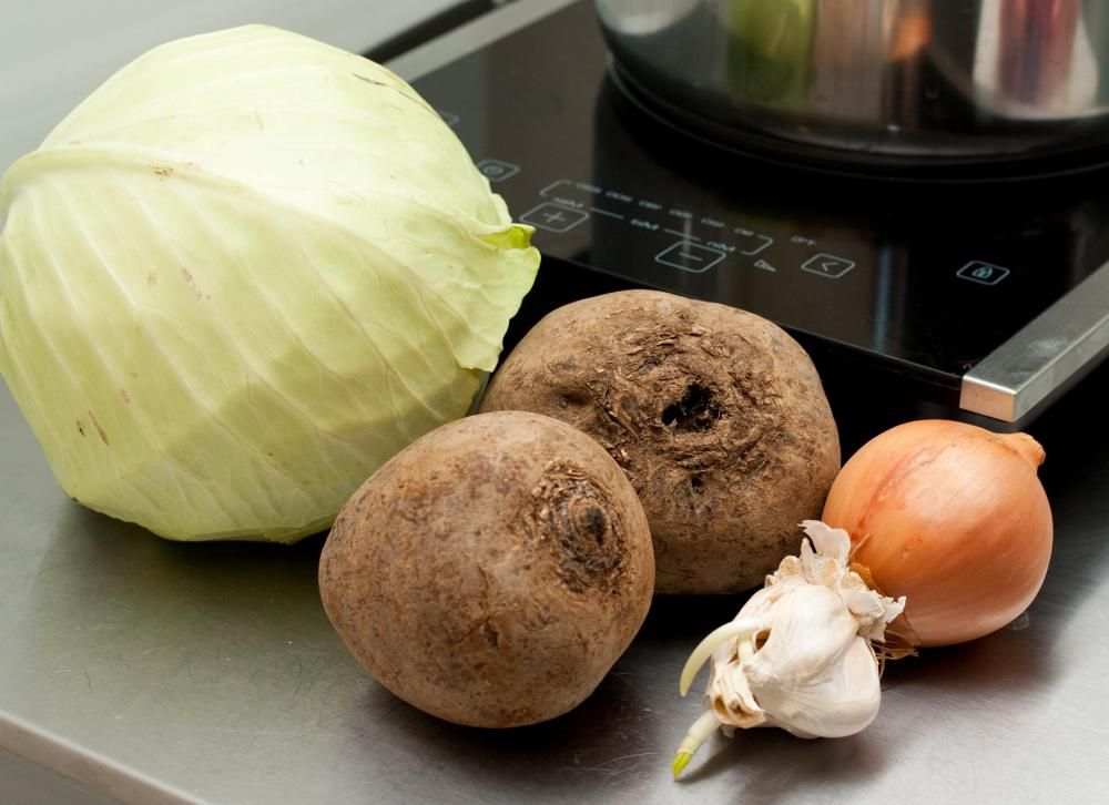 Ingredients for borscht include cabbage, beets, garlic and onion.