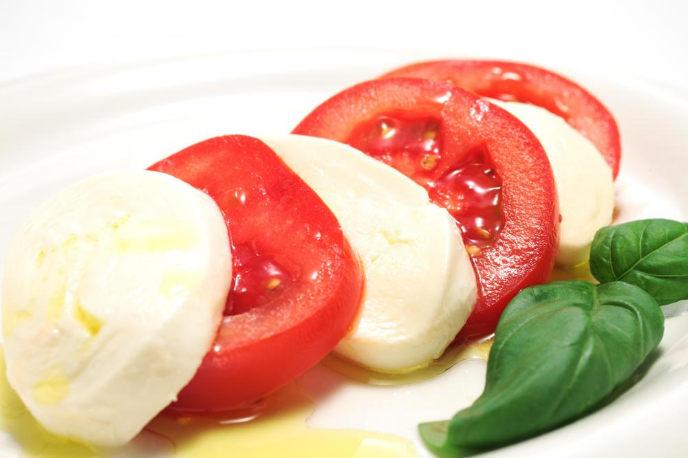 Caprese salad may be served as antipasto.
