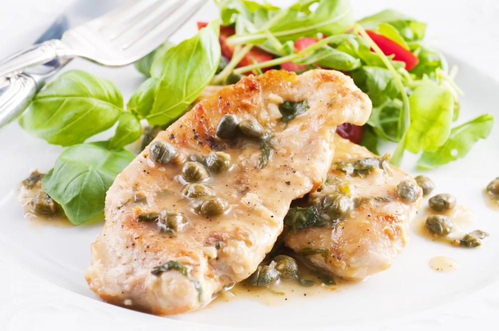 A photo of a plate of chicken piccata, which could accompany a restaurant review.