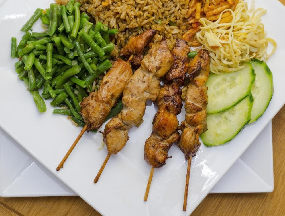 Marinated skewered chicken is often referred to as Satay Madura.