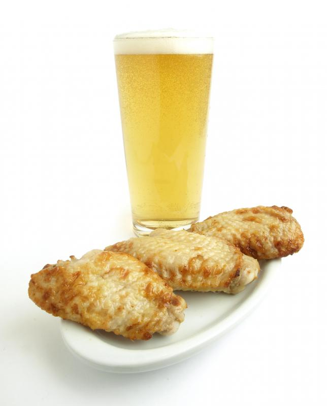 Some appetizers, such as chicken wings, are designed to be eaten with beer.