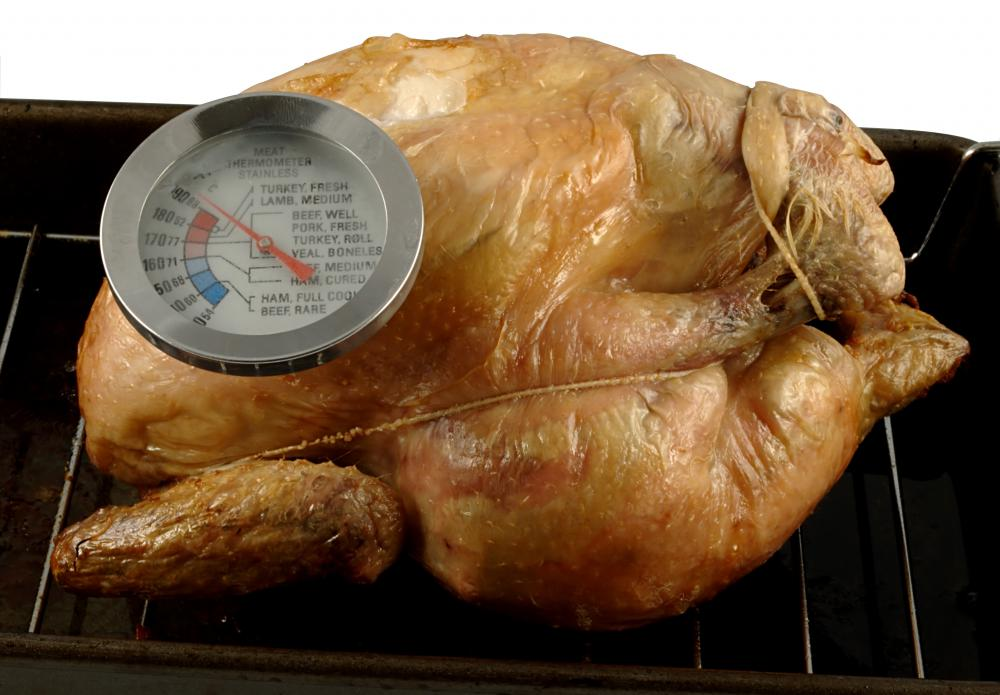 A meat thermometer, inserted in the thickest part of the breast, determines if the chicken is thoroughly cooked.