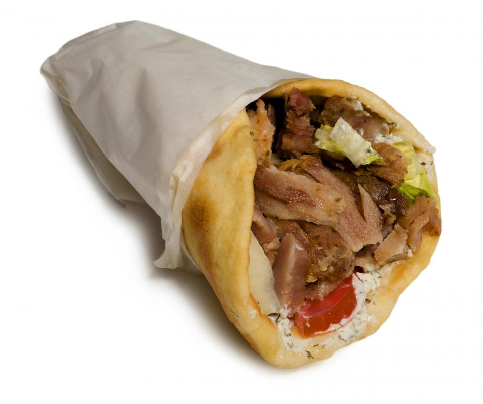 A gyro sandwich containing tzatziki.