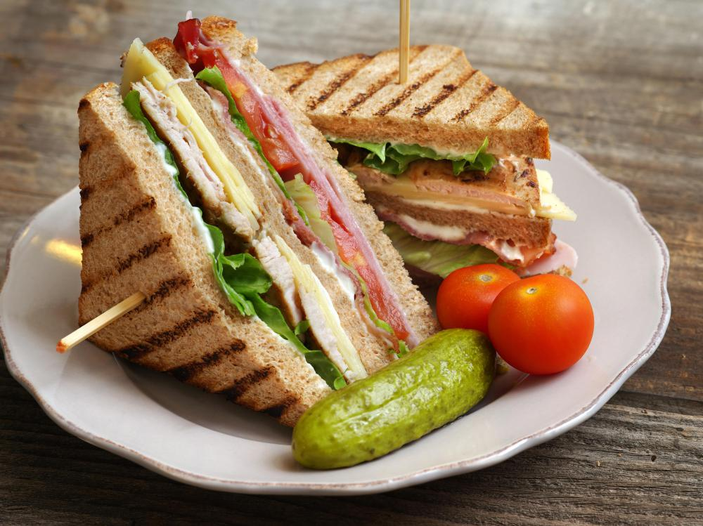 Turkey and chicken bacon can be used to make a club sandwich with a twist.