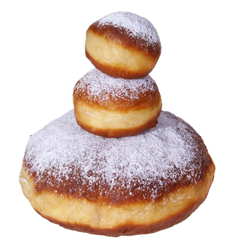 Donuts topped with powdered sugar.