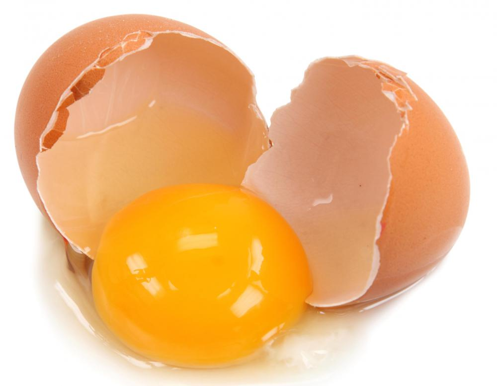 A cracked egg with the white and yolk.