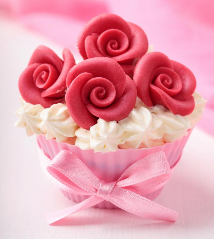 Cupcake decorated with marzipan, a type of almond paste.