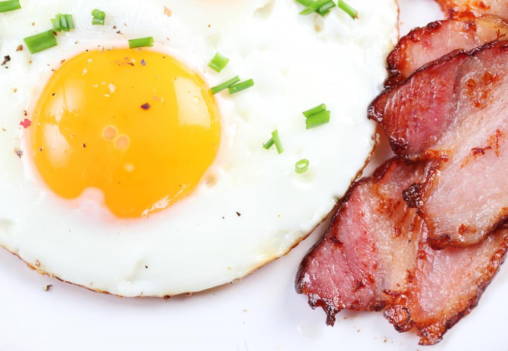 Fried eggs and bacon are typically cooked in a frying pan.