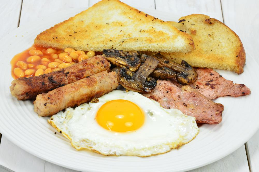Eggs, toast, sausage, and hash browns are an important part of an English breakfast.
