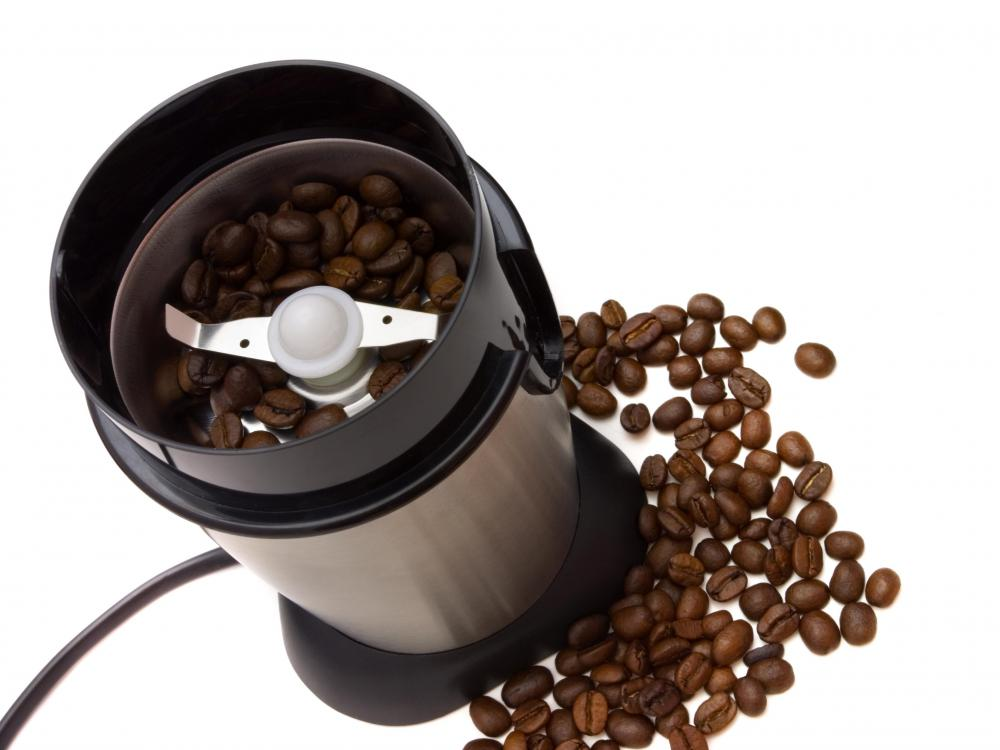 A modern, electric coffee grinder.