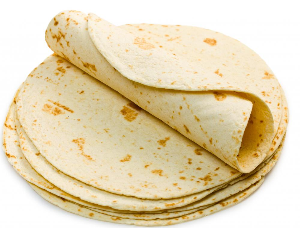 Flour tortillas are folded to make burritos.