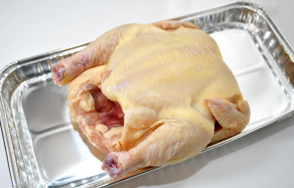 Salmonella is associated with raw chicken.