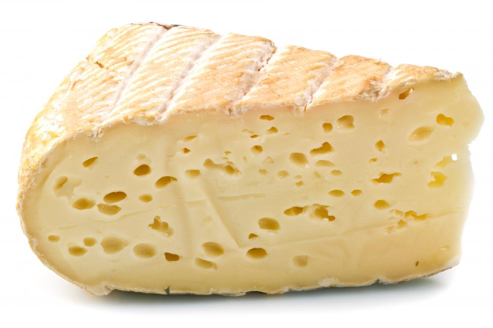 A thick wedge of fontina cheese.