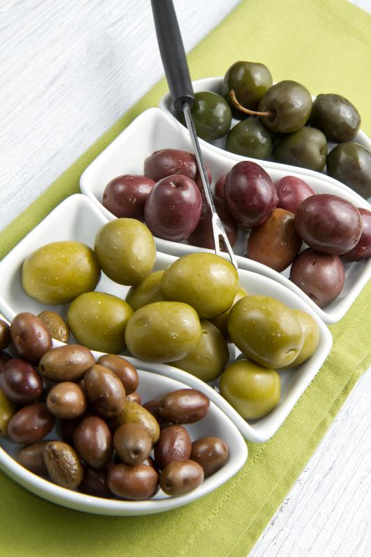 Different types of olives, including oil-cured olives.