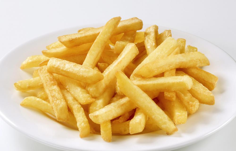 French fries are often served with condiments like ketchup or mayonnaise.