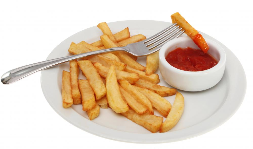 Steak fries may be served with ketchup.