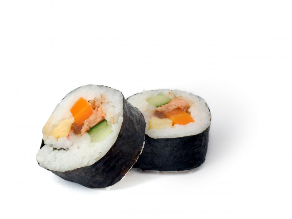Two futomaki rolls, which are made with much more seaweed than nigiri sushi.