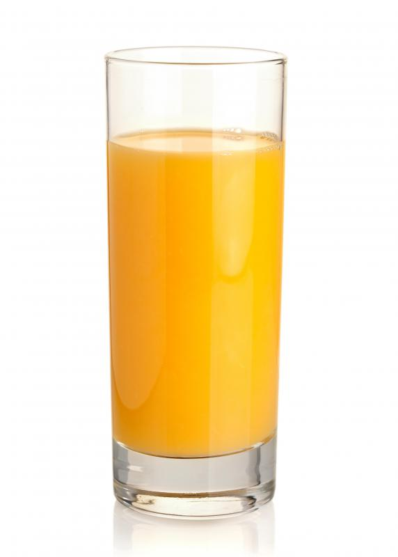 A glass of orange juice, which is used in making a fuzzy navel.
