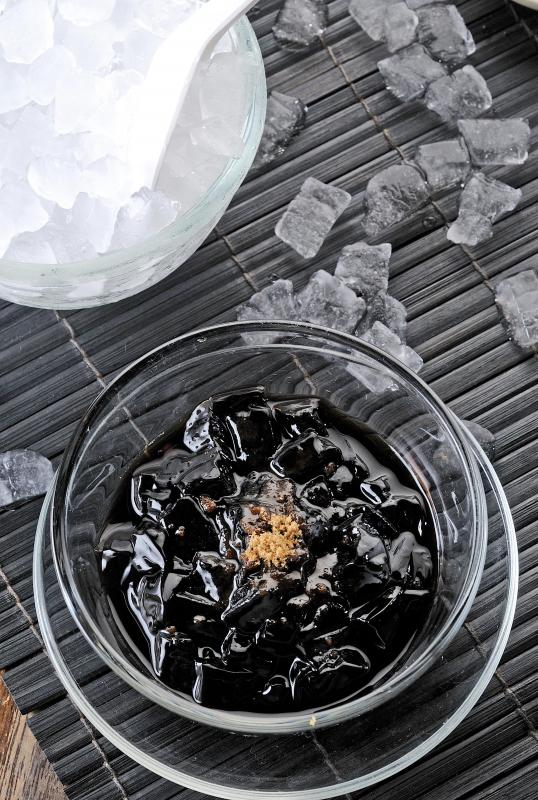 Grass jelly is a jiggly Asian dessert that has a shiny black or dark green appearance.