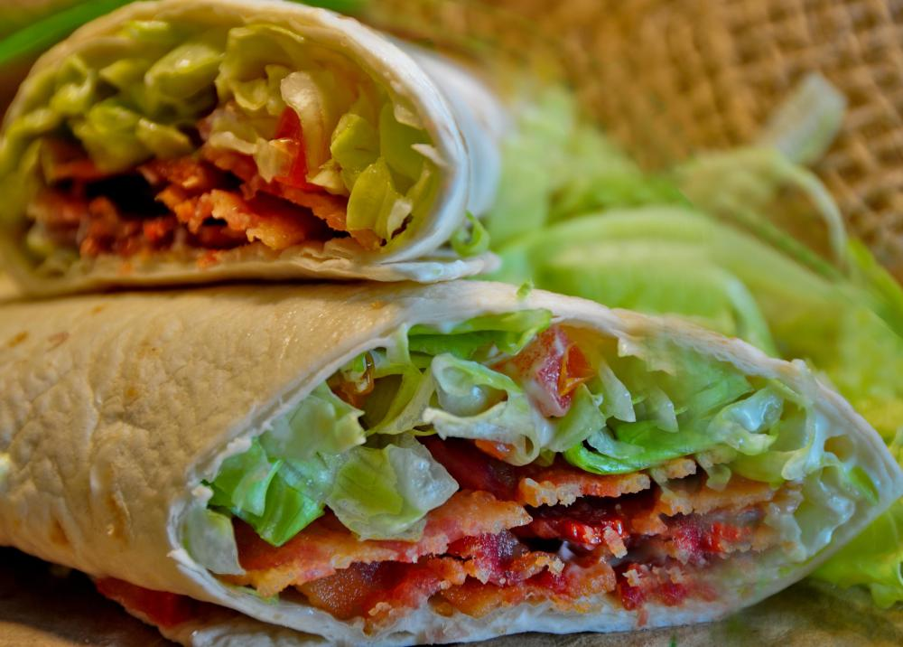 Flour tortillas can be used to make a BLT wrap sandwich made with chicken bacon, lettuce, and tomato.