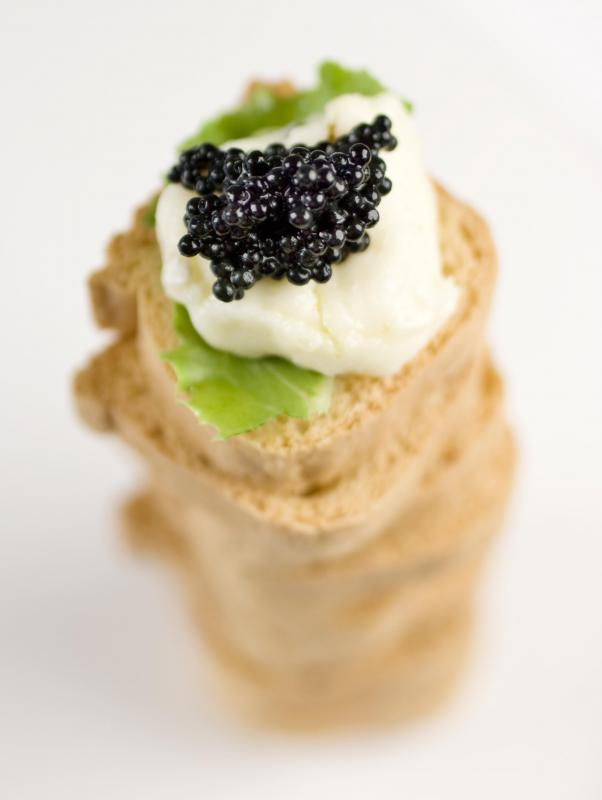 Caviar appetizer with crème fraîche and basil.