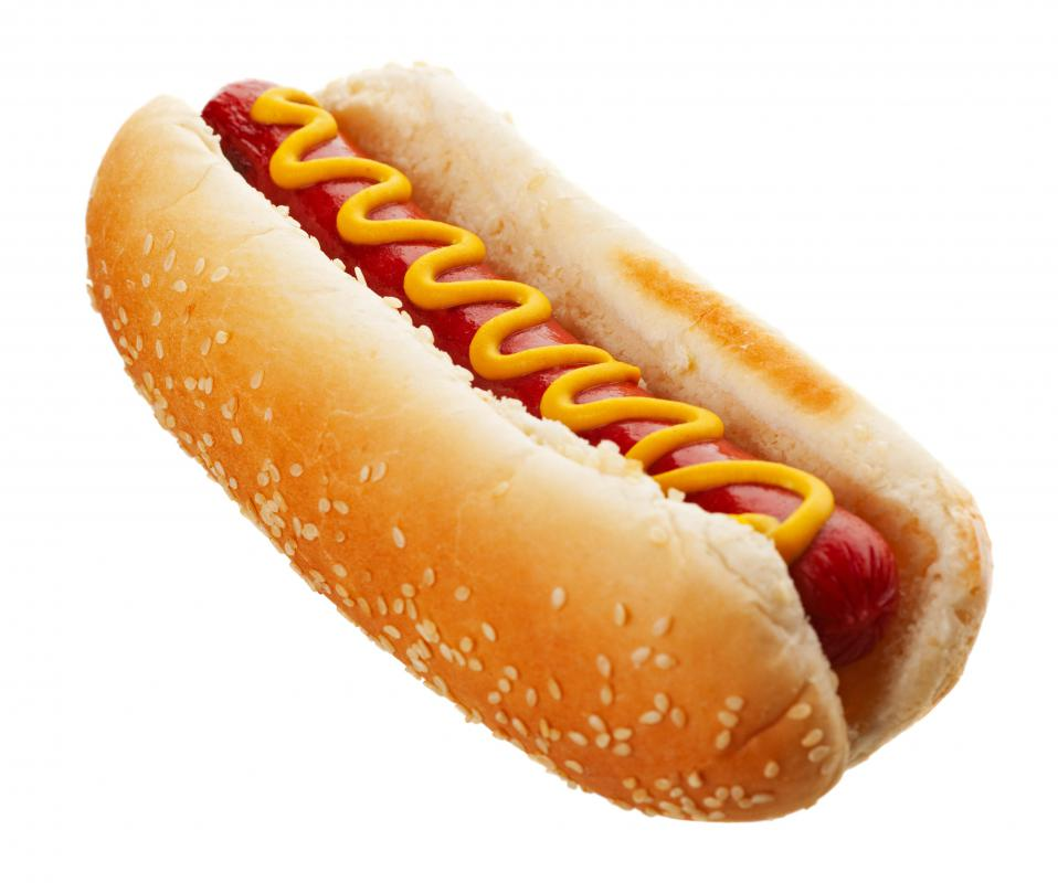 A hot dog with mustard, a condiment.