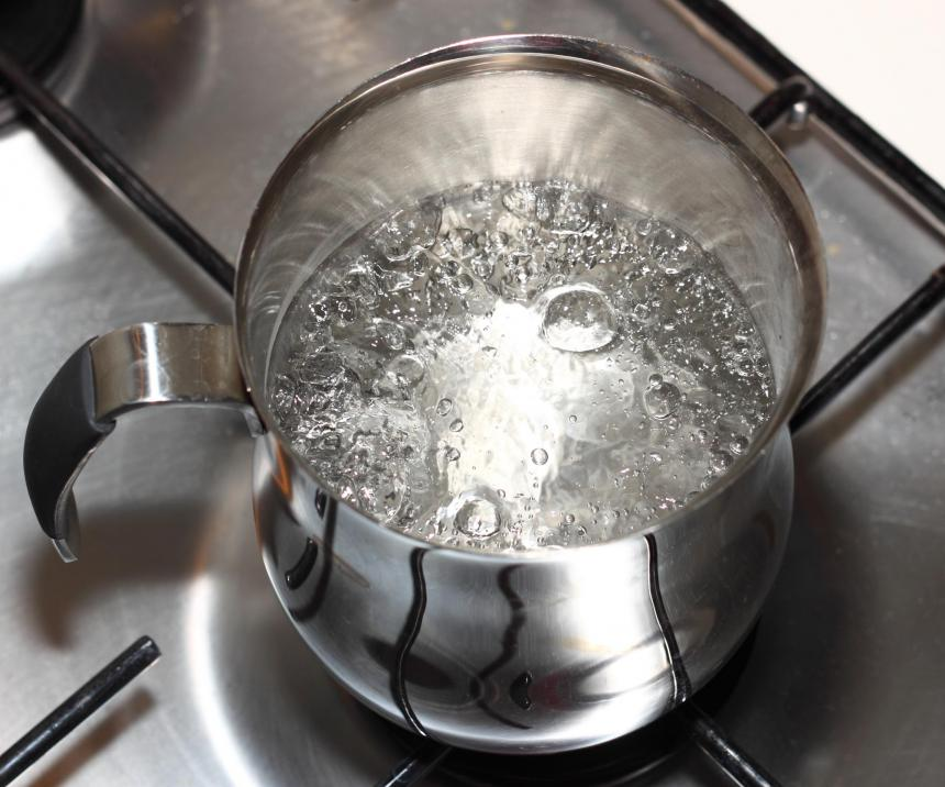 Large, continuous bubbles covering the surface of the water signal a rolling boil.