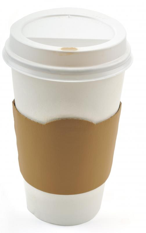 A large disposable coffee cup with a sleeve and lid, all of which can add to the price.