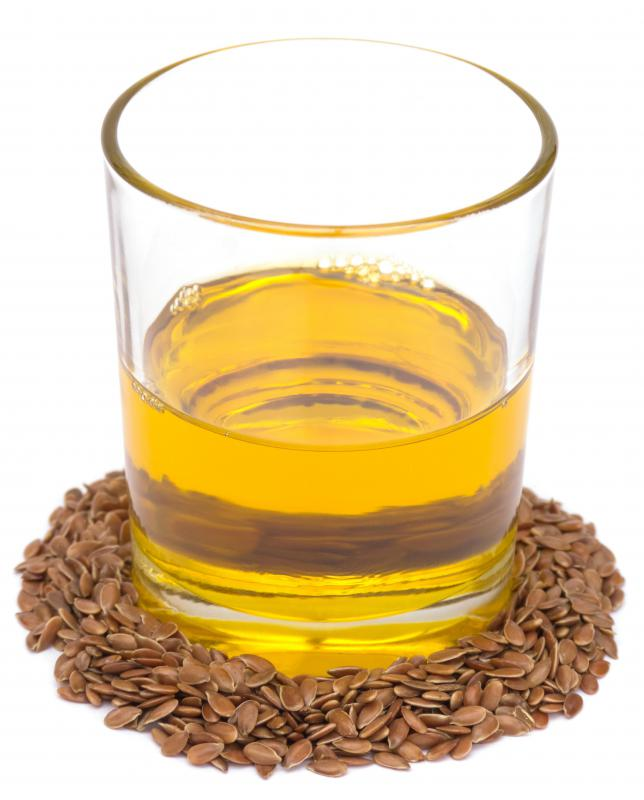 Cold pressed flaxseed oil and flax seeds.