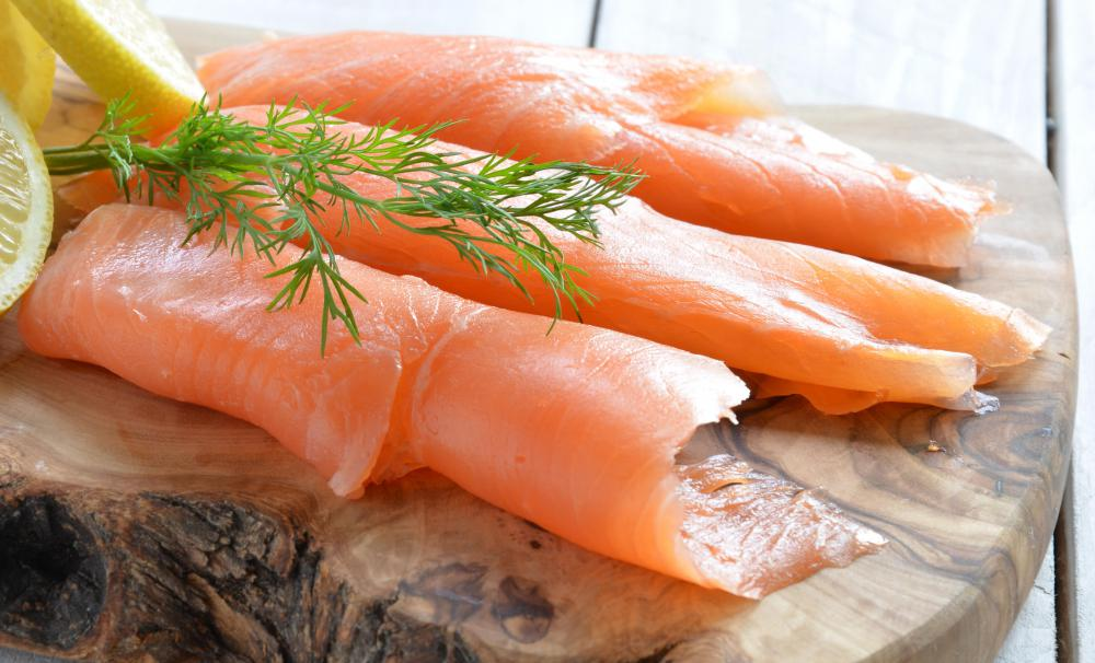 Lox, a thin filet of cured, cold smoked salmon, is commonly served with a schmear.