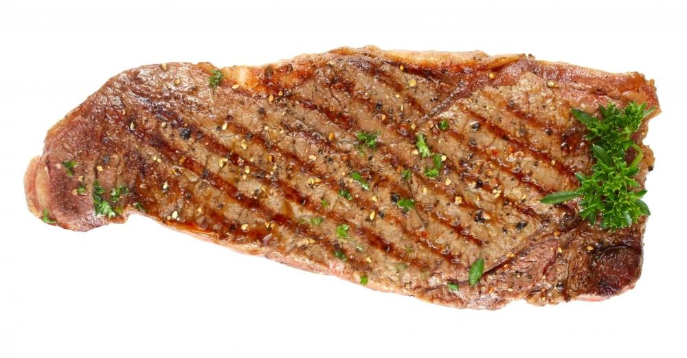 A steak with parsley.