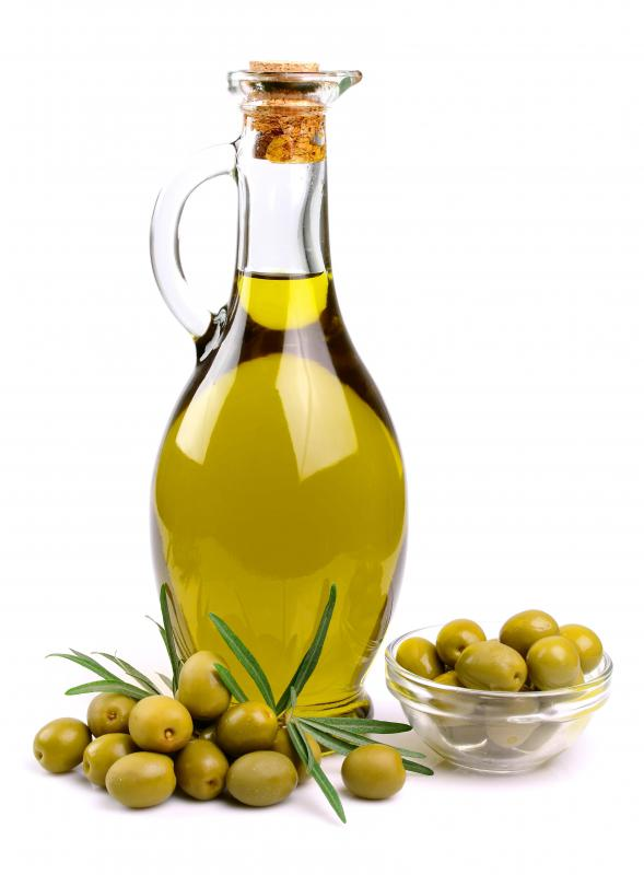 Olive oil is typically used on the bread before the addition of tomatoes for bruschetta.