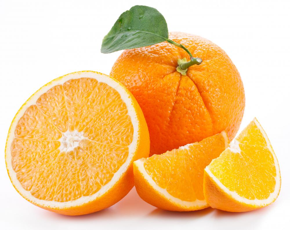 Portions of oranges and other items are measured with a kitchen scale.