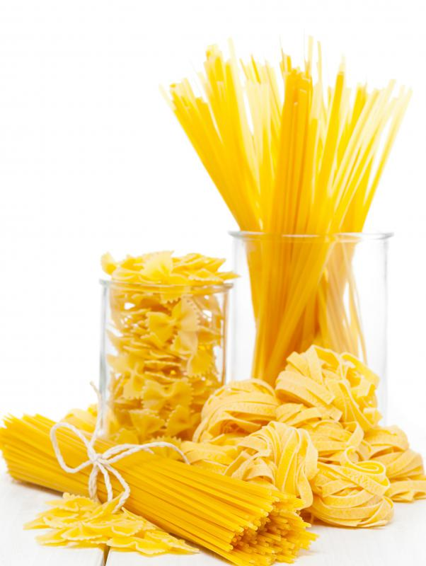 A kitchen scale may be used to weigh pasta.