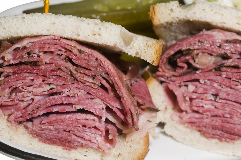 A sandwich made with pastrami, a type of cold cut.