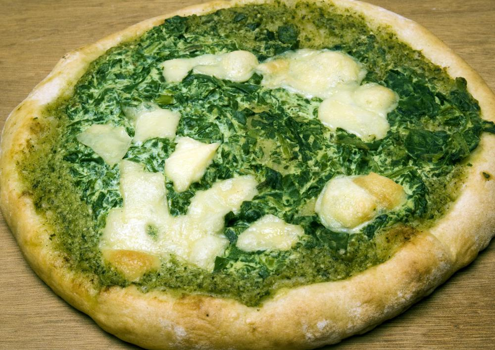 Green pesto can be used instead of red sauce on a pizza.