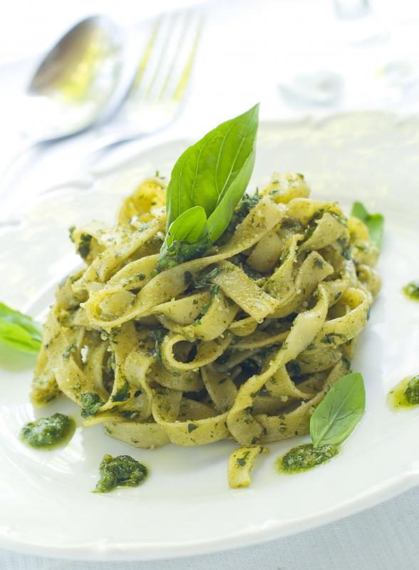 Pasta with pesto sauce made with garlic scape.