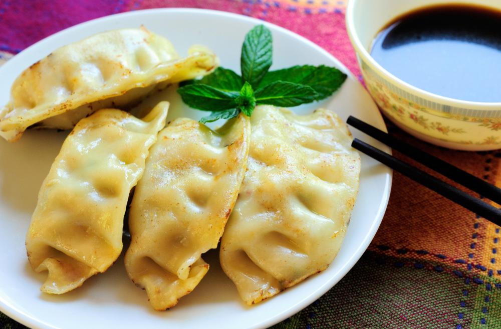 Potstickers can be served steamed with a dipping sauce on the side.
