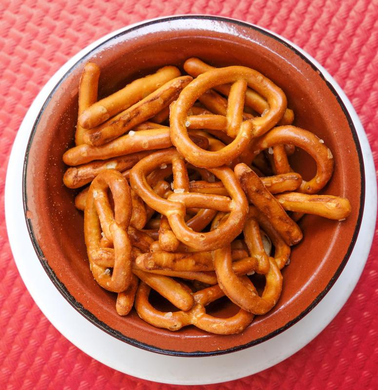 Pretzels dipped in mustard are a tasty snack.