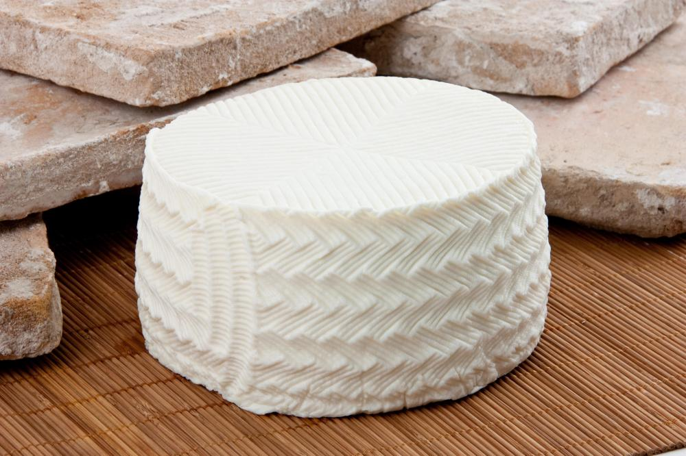 Queso fresco, which is used in making flautas.