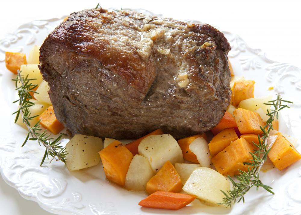 Rump roast may be served with sliced vegetables.