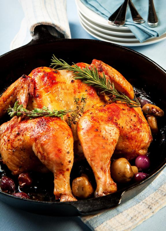 Butterflying a whole chicken will help it cook faster and evenly.