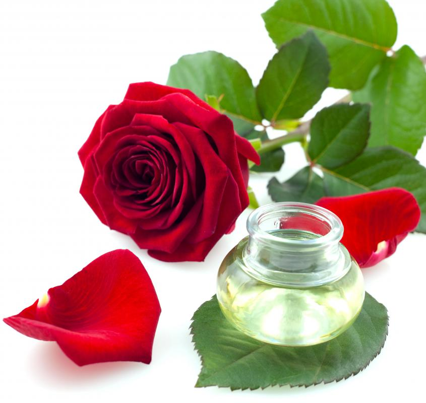 Rose water and a red rose.